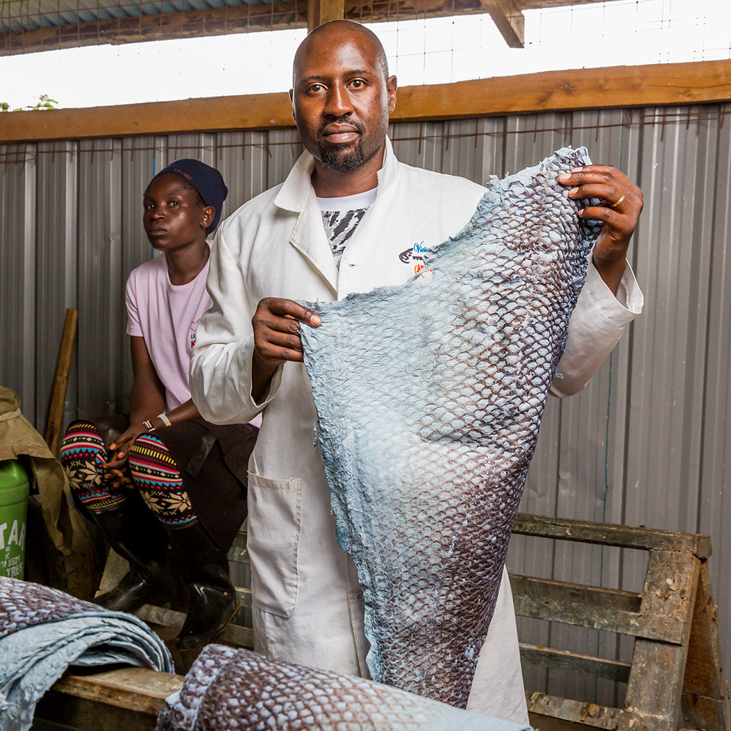 CEO James Ambani displays a sample of processed fish leather